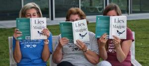 women read on bench